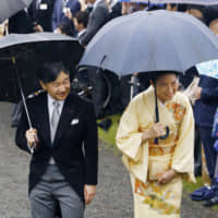 Then-Crown Prince Naruhito and then-Crown Princess Masako attend a garden party at the Akasaka Imperial Gardens in Tokyo in November 2018.   KYODO