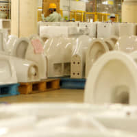 Toilets ready for shipment cover the floor of a Toto toilet factory in Kitakyushu. | REUTERS