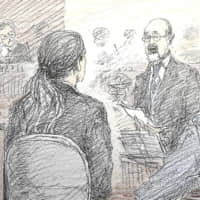 A court illustration shows Takashi Ono (center), whose son sustained severe injuries in a 2016 knife rampage in a care home in Sagamihara, Kanagawa Prefecture, questioning Satoshi Uematsu (left) at his trial at the Yokohama District Court on Wednesday. | KYODO