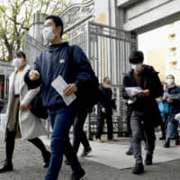 Virus-hit Japanese schools close in the lead-up to graduation ceremonies