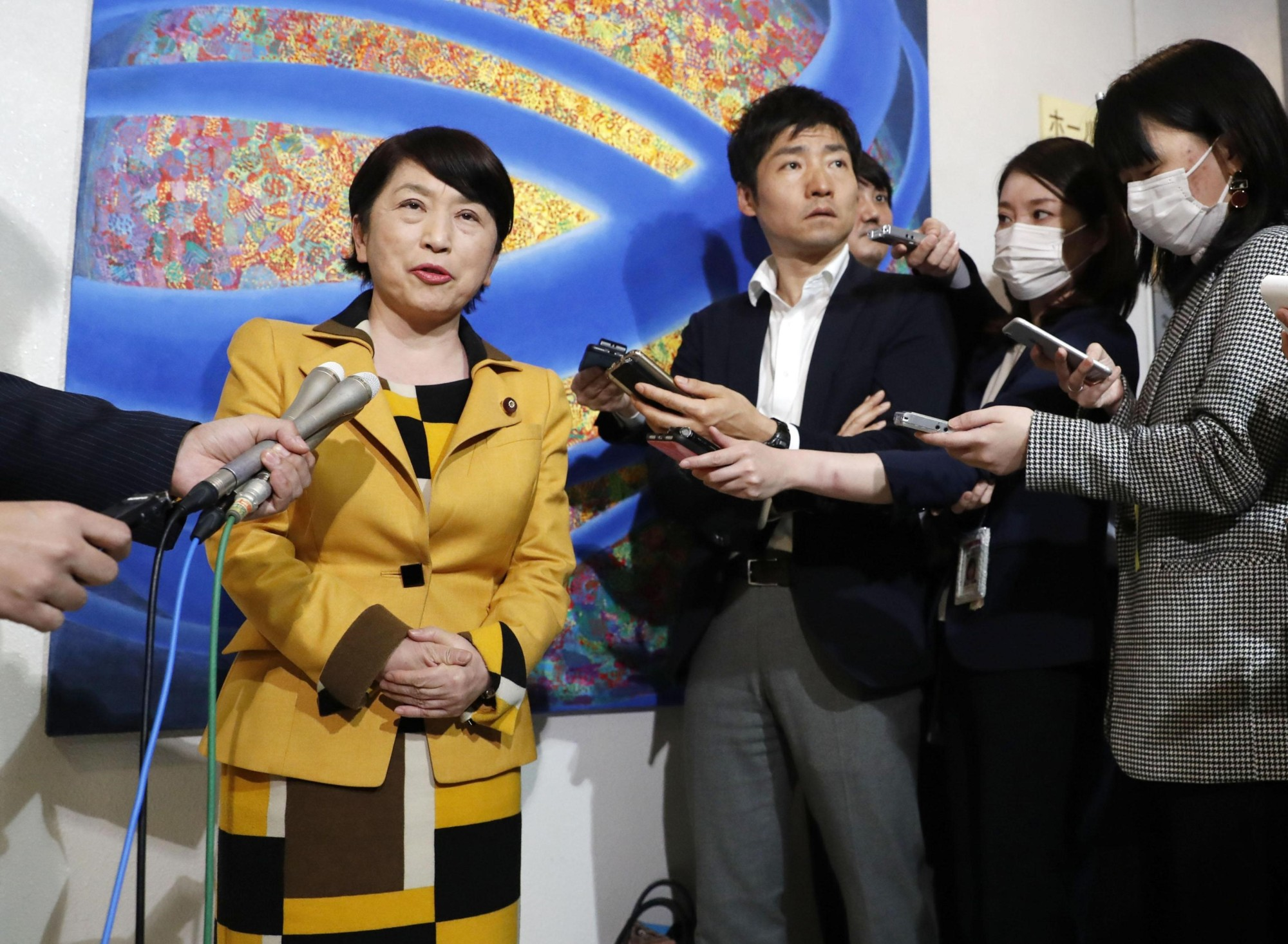 Newly elected Social Democratic Party chief Mizuho Fukushima speaks to reporters on Saturday after she was reelected to the party's top position. She previously led the party from 2003 to 2013. | KYODO