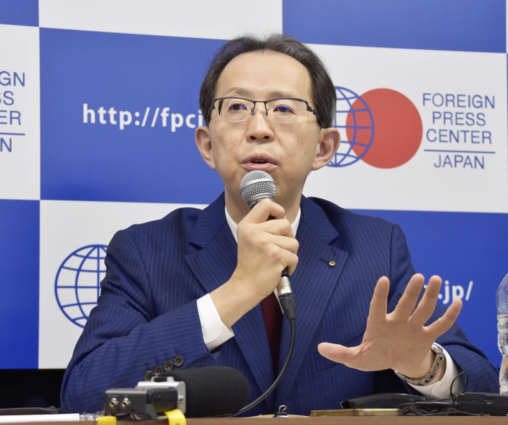 Fukushima Gov. Masao Uchibori speaks about hosting part of the Tokyo 2020 Olympics, at a news conference in Tokyo on Tuesday.   KYODO