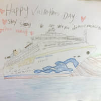 Yardley Wong, a passenger on the Diamond Princess, tweeted this Valentine's Day card drawn by her 6-year-old son Carlos for the crew of the cruise ship, which has been quarantined in Yokohama Bay since Feb. 4. | YARDLEY WONG