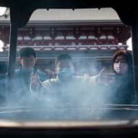 Though Japan has barred entry to foreign nationals who have recently traveled near the city of Wuhan, the epicenter of the coronavirus outbreak, the government faces the urgent task of preparing health care providers for a large number of patients. | AFP-JIJI