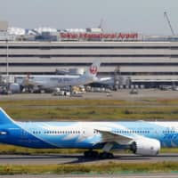 A Boeing 787 jet operated by China Southern Airlines taxis at Haneda Airport in Tokyo. At least 13 regional airports in Japan will completely suspend regular flights to and from mainland China over the novel coronavirus outbreak, they say. | KYODO