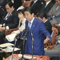 Prime Minister Shinzo Abe speaks during a Lower House Budget Committee meeting on Tuesday at the Diet. | KYODO