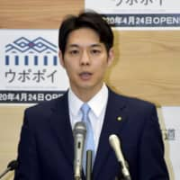 Hokkaido Gov. Naomichi Suzuki speaks about new COVID-19 cases in his prefecture at a news conference Friday. | KYODO