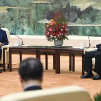World Health Organization Director-General Tedros Adhanom Ghebreyesus and Chinese President Xi Jinping hold talks in Beijing on Jan. 28. | KYODO