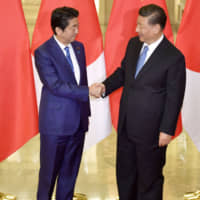 Prime Minister Shinzo Abe meets with Chinese President Xi Jinping at the Great Hall of the People in Beijing in December. | KYODO