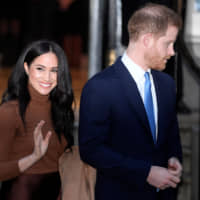 Stepping out: Prince Harry and his wife Meghan, Duchess of Sussex, leave Canada House in London last month. | REUTERS