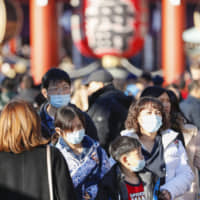 Better safe than sorry: Foreign tourists wear masks in Tokyo. | KYODO