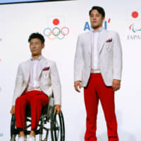 Gold-medal outfits: Athletes model the official uniforms that the Japanese delegation is set to wear at the opening ceremonies of the Tokyo Olympics. | GETTY IMAGES