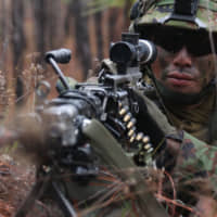 A member of the Ground Self-Defense Force trains with the U.S. 25th Infantry Division at the Joint Readiness Training Center in Fort Polk, Louisiana, on Jan. 16.   JOINT READINESS TRAINING CENTER OPERATIONS GROUP