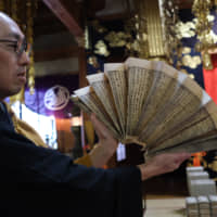 Good karma: A monk shows off sutras at Zenpoji temple, in the city of Tsuruoka. | JESSE CHASE-LUBITZ