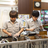 Get to the point: Aritsugu sells and repairs knives and other tools for professional use, including the tekagi hooks indispensable at tuna auctions. At the front of the shop, craftsmen sharpen knives with great concentration.