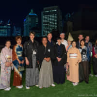 Team JCQ: Nao Hirano (center) with members of the volunteer group Japan Community of Queensland Inc. | JOHN PRYKE PHOTOGRAPHER