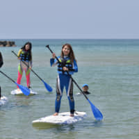 Stand-up paddleboarding is a popular aquatic activity offered in Kyotango. | KYOTANGO CITY TOURISM ASSOCIATION