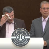 Iranian Deputy Health Minister Iraj Harirchi wipes his face during a Feb. 24 news briefing in Tehran. The next day, the government announced that Harirchi had tested positive for COVID-19 amid concerns the outbreak may be far wider in Iran than officially acknowledged. | AP