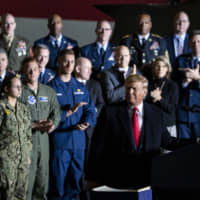 U.S. President Donald Trump speaks during a Dec. 20 signing ceremony for the $738 billion National Defense Authorization Act, which established the U.S. Space Force | BLOOMBERG