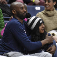 Kobe Bryant and his daughter, Gianna, attend a University of Connecticut women's basketball game on March 2019 in Storrs, Connecticut. | AP