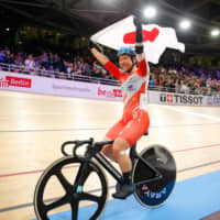 Yumi Kajihara celebrates after winning the omnium event at the World Track Cycling Championships on Friday in Berlin. | AFP-JIJI