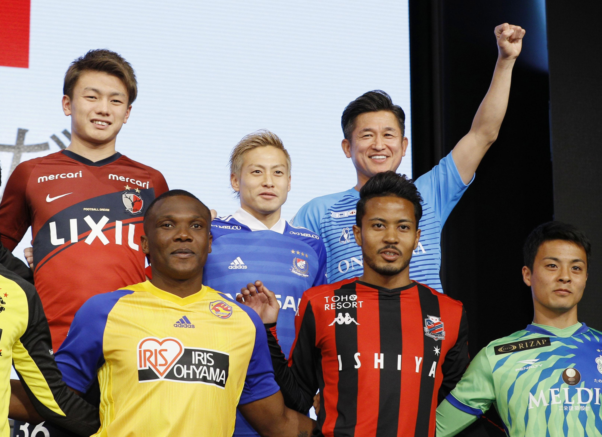 Kazuyoshi Miura of the Yokohama FC (top right) poses with other J. League players during a photo session at the J. League Kickoff Conference on Friday at a Tokyo hotel. | KYODO