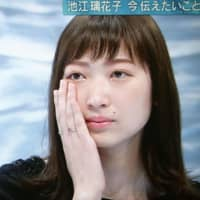 Rikako Ikee wipes away a tear during an interview that was aired on Wednesday night. | KYODO