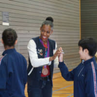 U.S. track great DeeDee Trotter motivates junior high school students