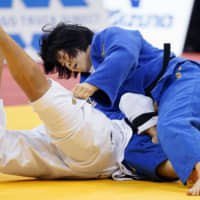 Shori Hamada (right) grapples with Brazil's Mayra Aguiar in the women's 78-kg final at the Dusseldorf Grand Slam on Sunday in Dusseldorf, Germany. | KYODO