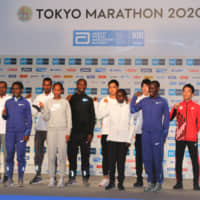 Elite runners of the men's and women's competitions for the 2020 Tokyo Marathon pose for photos at a news conference on Friday. | KAZ NAGATSUKA