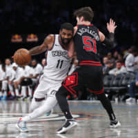 Brooklyn's Kyrie Irving drives on Chicago's Ryan Arcidiacono in the second half on Friday night. | USA TODAY / VIA REUTERS