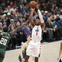 Wizards rookie Rui Hachimura shoots a jumper on Monday against the Bucks. Hachimura scored 12 points in Washington's overtime loss. | KYODO