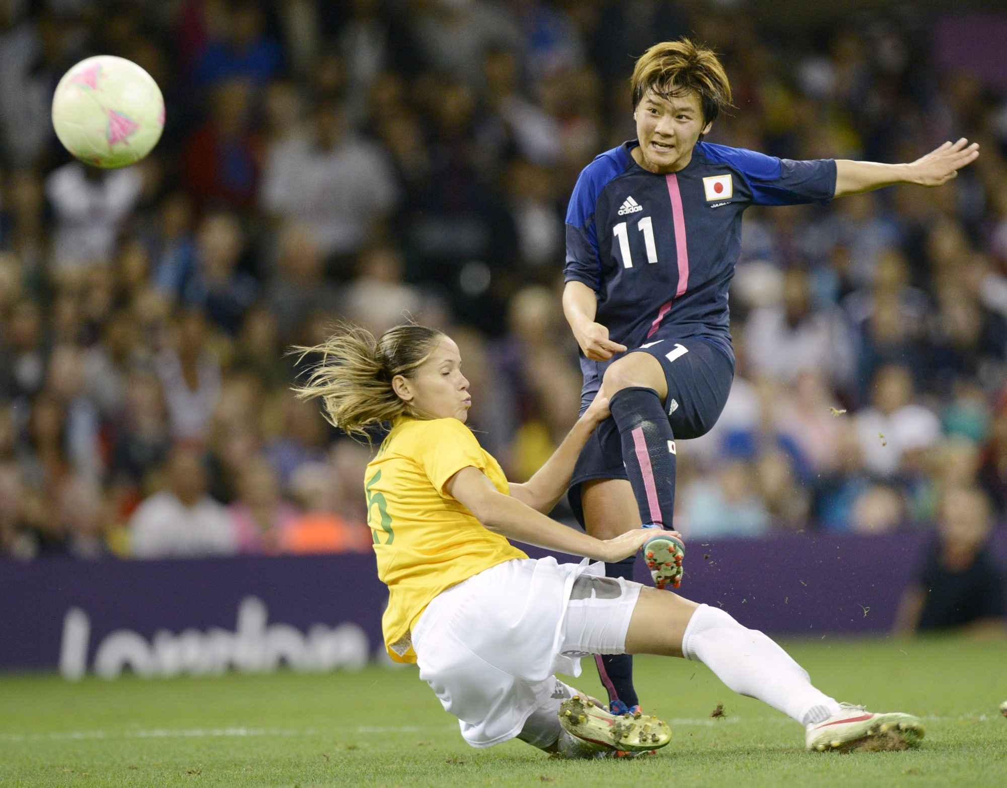 Shinobu Ono (right) scores for Japan against Brazil in the quarterfinals of the 2012 London Olympics women's soccer tournament on Aug. 3, 2012, in Cardiff. | KYODO