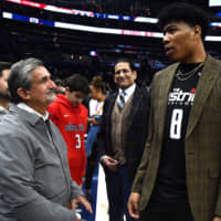 Wizards rookie forward Rui Hachimura talks with owner Ted Lionsis after Thursday's game against the Hornets at Capital One Arena. | USA TODAY / VIA REUTERS