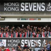 The Japanese team celebrates after beating Hong Kong on the third day of the rugby sevens tournament in Hong Kong on April 10, 2016. | AFP-JIJI