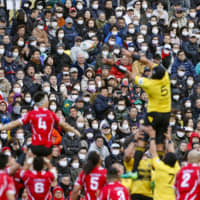 Spectators wear masks during a Top League match at Prince Chichibu Memorial Rugby Ground on Feb. 22. | REUTERS
