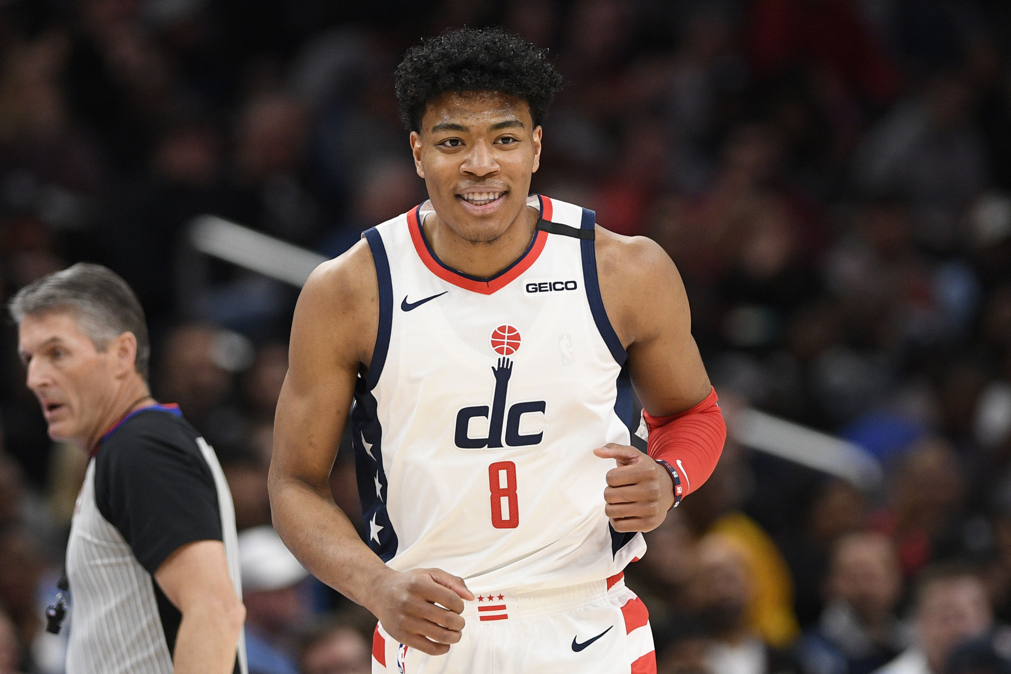 Wizards forward Rui Hachimura runs down the court during the first half of an NBA game against the Memphis Grizzlies on Sunday in Washington. | AP
