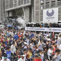 Runners compete in the 2019 edition of the Tokyo Marathon on March 3, 2019. Organizers on Monday announced that only elite runners will participate in the 2020 race due to the COVID-19 outbreak. | KYODO