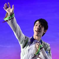 Gold medalist Yuzuru Hanyu celebrates during the men's awards ceremony at the Four Continents on Saturday. | AFP-JIJI