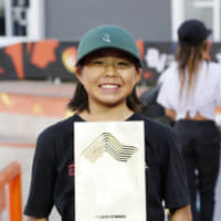 Misugu Okamoto poses with her trophy after winning the women's competition at the Skateboarding World Championships in Sao Paulo on Sept. 14, 2019. | KYODO