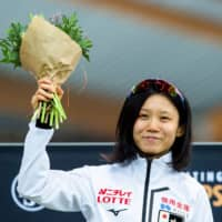 Miho Takagi celebrates after winning the women's 10,000-meter race at the ISU World Sprint and Allround Speed Skating Championships on Friday in Hamar, Norway. | REUTERS
