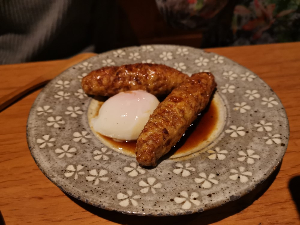 The chicken and the egg: The menu at En Shibuya offers some izakaya bar classics, such as tsukune (chicken meatballs) served with an onsen tamago (soft-cooked egg).   PHOEBE AMOROSO