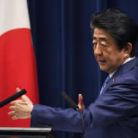 Prime Minister Shinzo Abe delivers a speech at the Prime Minister's Office in Tokyo on Saturday. | AP