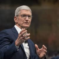 Apple CEO Tim Cook is offering employees at most of its global offices the option of working from home to deal with the coronavirus outbreak. | BLOOMBERG