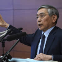 Bank of Japan Gov. Haruhiko Kuroda speaks to the media in Tokyo on Monday after the central bank decided on additional easing steps. | AP