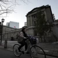 The Bank of Japan is reportedly planning to boost its purchases of exchange-traded funds as part of steps to support the volatile stock market amid the coronavirus outbreak. | BLOOMBERG