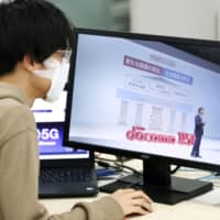 NTT Docomo Inc. President Kazuhiro Yoshizawa holds an online news conference Wednesday in Tokyo to announce the launch of smartphone services based on superfast 5G technology on March 25. The news conference went online out of concern over the spread of the new coronavirus. | KYODO