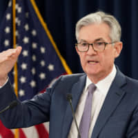 U.S. Federal Reserve Chairman Jerome Powell speaks to reporters at a news conference Tuesday in Washington after the central bank cut interest rates in an emergency move designed to shield the world's largest economy from the impact of the coronavirus. | REUTERS