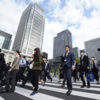 The coronavirus outbreak caused almost half of Japanese firms to see their output and sales slide last month, according to a recent poll. | BLOOMBERG