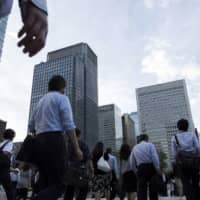 Amid the outbreak of COVID-19, business sentiment among large Japanese firms sank to the worst in five years and nine months, according to a government survey disclosed Thursday. | BLOOMBERG